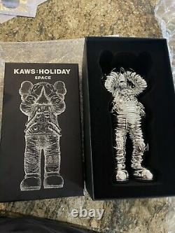 Kaws Holiday Space Silver In Hand