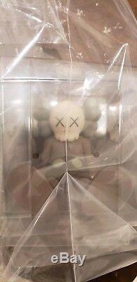 Kaws holiday Seated Figure all rights reserved Limited Edition Companion Brown
