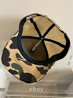 NewithNever Worn OG Bape A Bathing Ape x Kaws Yellow Camo Trucker Hat. Authentic